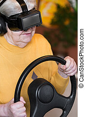 senior adult with virtual reality glasses and steering wheel