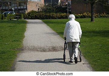 Senior woman with a walking frame.