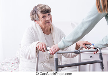 Senior with walking zimmer - Photo of senior lady with...