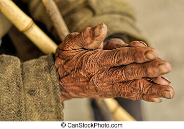 Senior with wrinkled hands - Wrinkled hands of an Indian...