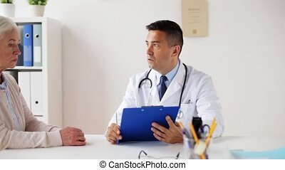 senior woman and doctor meeting at hospital - medicine, age,...