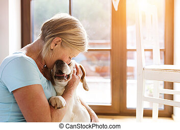 Senior woman and dog - Senior woman with her dog inside of...