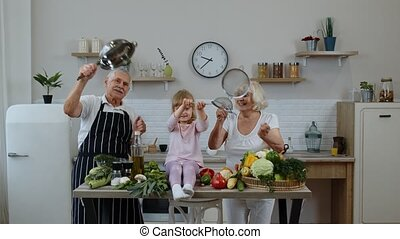 Senior woman and man with grandchild girl making a funny ...