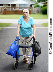 senior woman and walker overloaded