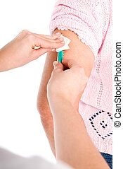Senior woman arm getting vaccine