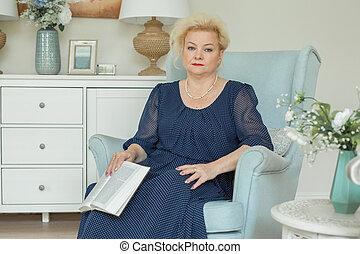 Senior woman at home, 60s