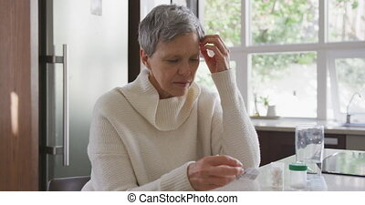 Senior woman at home alone - Front view of a senior...