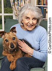 Senior woman At Home With Pet Dog