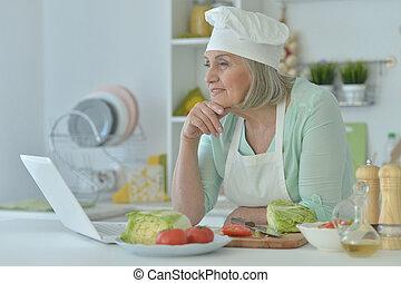 Senior woman at kitchen