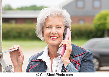 Senior woman at phone