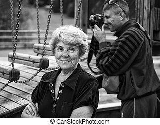 Senior Woman at the Park with photographer on background