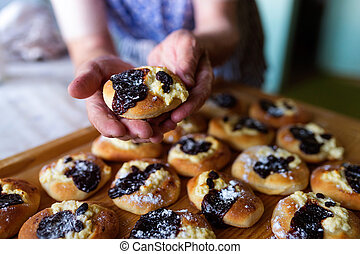 Senior woman baking - Senior woman holding freshly baked...
