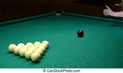 Senior woman break the in triangle billiard balls, on billiard table and getting to start game