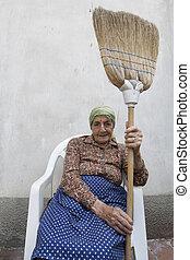 senior woman broom