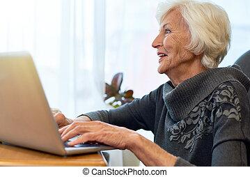 Senior Woman Browsing Internet