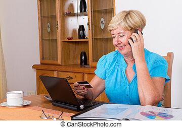 senior woman buying online