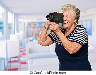 Senior Woman Capturing Photo