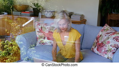 Senior woman checking bills on sofa 4k - Senior woman...