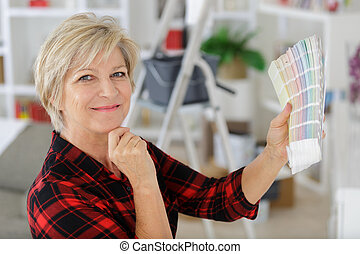 senior woman choosing from colour swatches