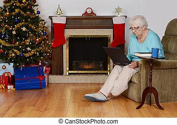 senior woman christmas shopping