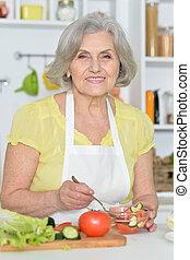 Senior woman cooking in kitchen