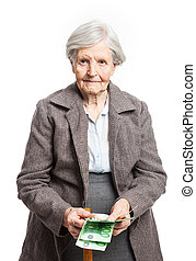 Senior woman counting money on white background