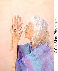 Senior Woman Devotion - Photograph of a senior woman in...