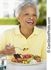 Senior Woman Dining Al Fresco
