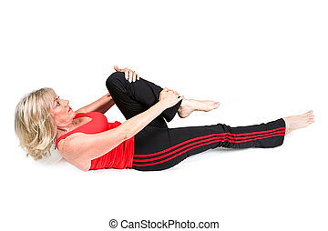 Senior Woman Does Back Exercises