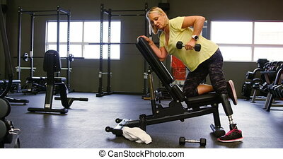 Senior woman doing dumbbell row exercise 4k - Senior woman...