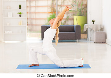 senior woman doing exercise at home