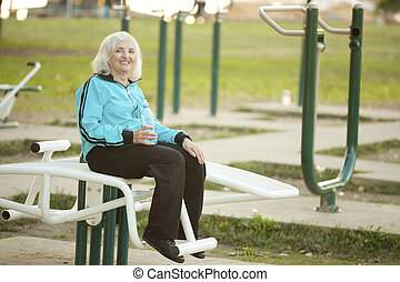 Senior Woman doing Exercises Outdoors