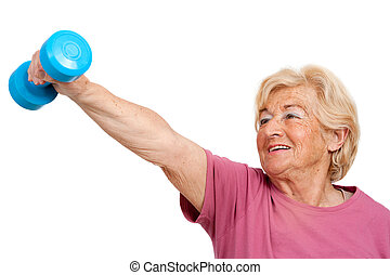 Senior woman doing fitness exercise. - Portrait of healthy...