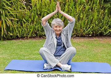 Senior woman doing her streches in