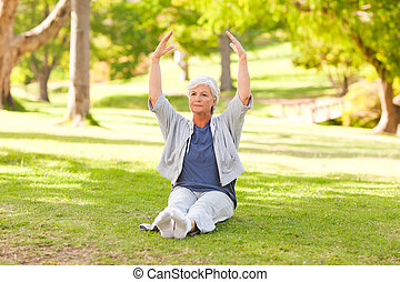 Senior woman doing her stretches in