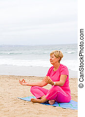 senior woman doing meditation
