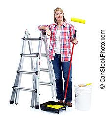 Senior woman doing renowation at home. Painter.