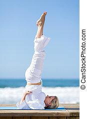 senior woman doing stretching exercise