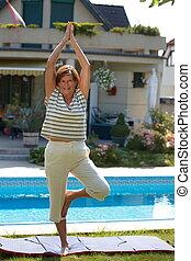 Senior woman doing yoga