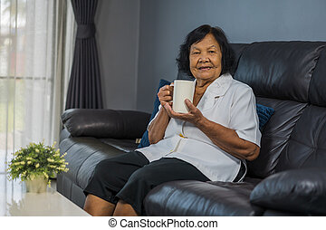senior woman drinking a cup of water