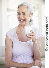 Senior Woman Drinking A Glass Of Milk