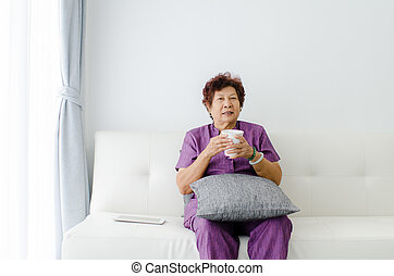 senior woman drinking tea at home.