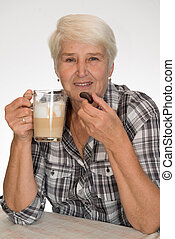 senior woman drinks coffee