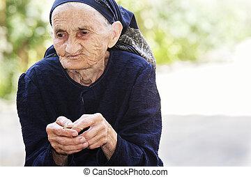 Senior woman eating cherry