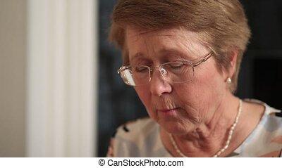 Senior woman eating homemade food
