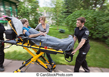 Senior Woman Emergency Transport - Senior woman being rushed...