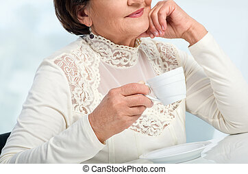 Senior Woman enjoying cup of coffe
