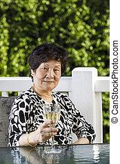 Senior Woman enjoying drink Outdoors