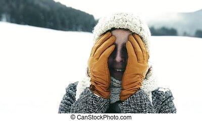 Senior woman enjoying herself on a winter day.