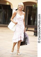 Senior Woman Enjoying Shopping Trip